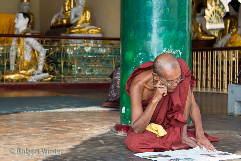 monk reading paper